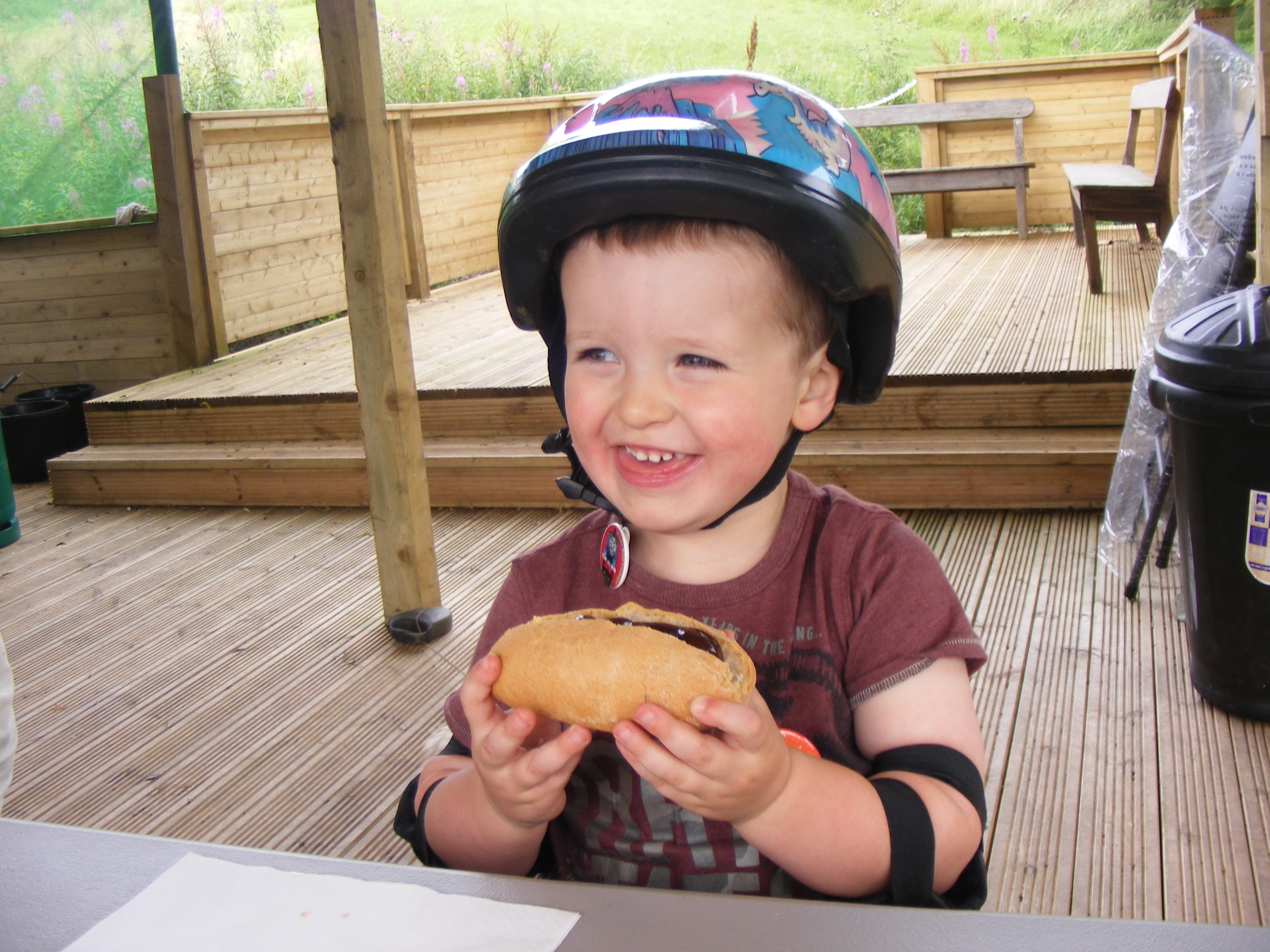 Happy lad with his hotdog