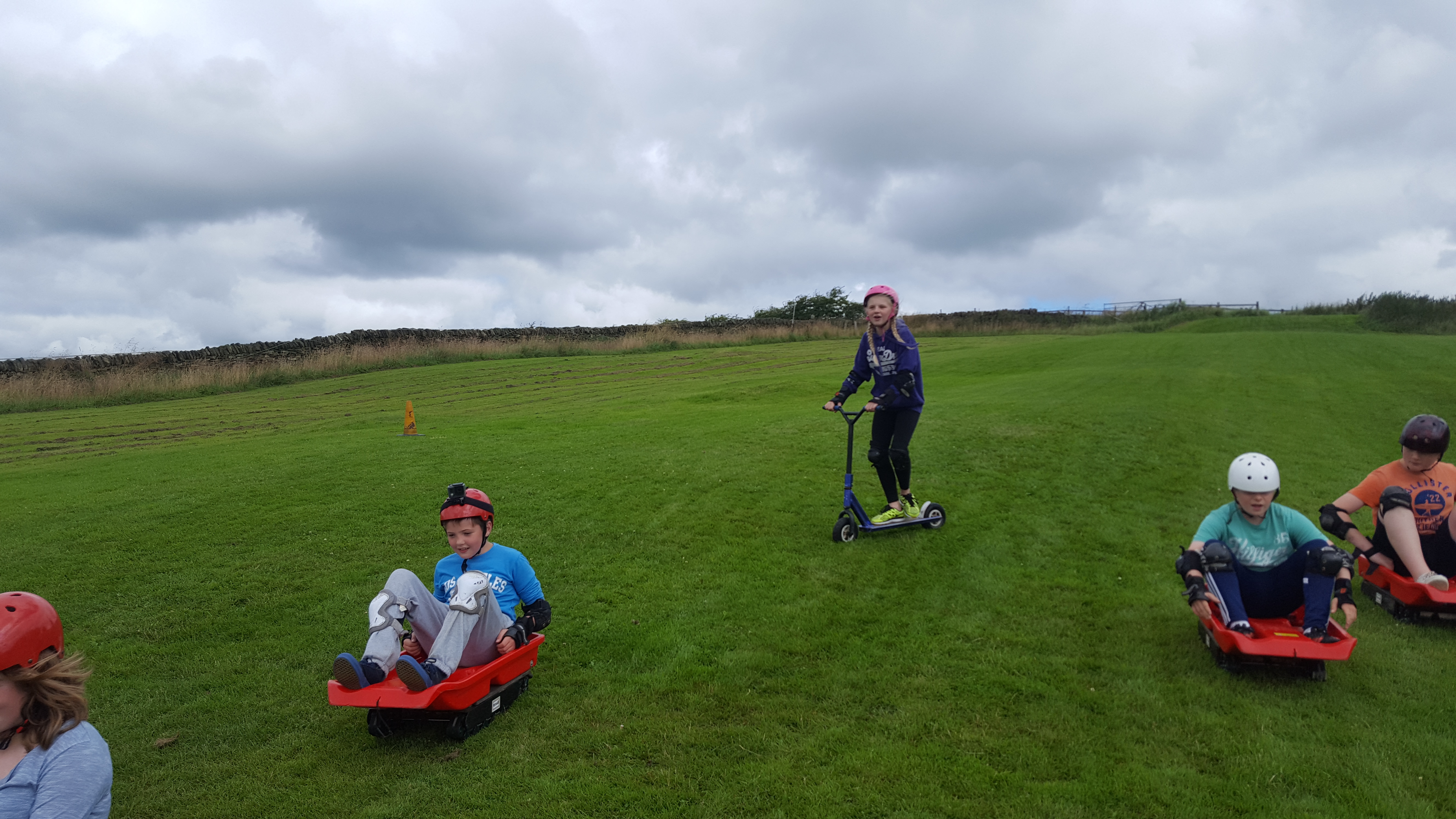 Grass sledging and dirt scooters