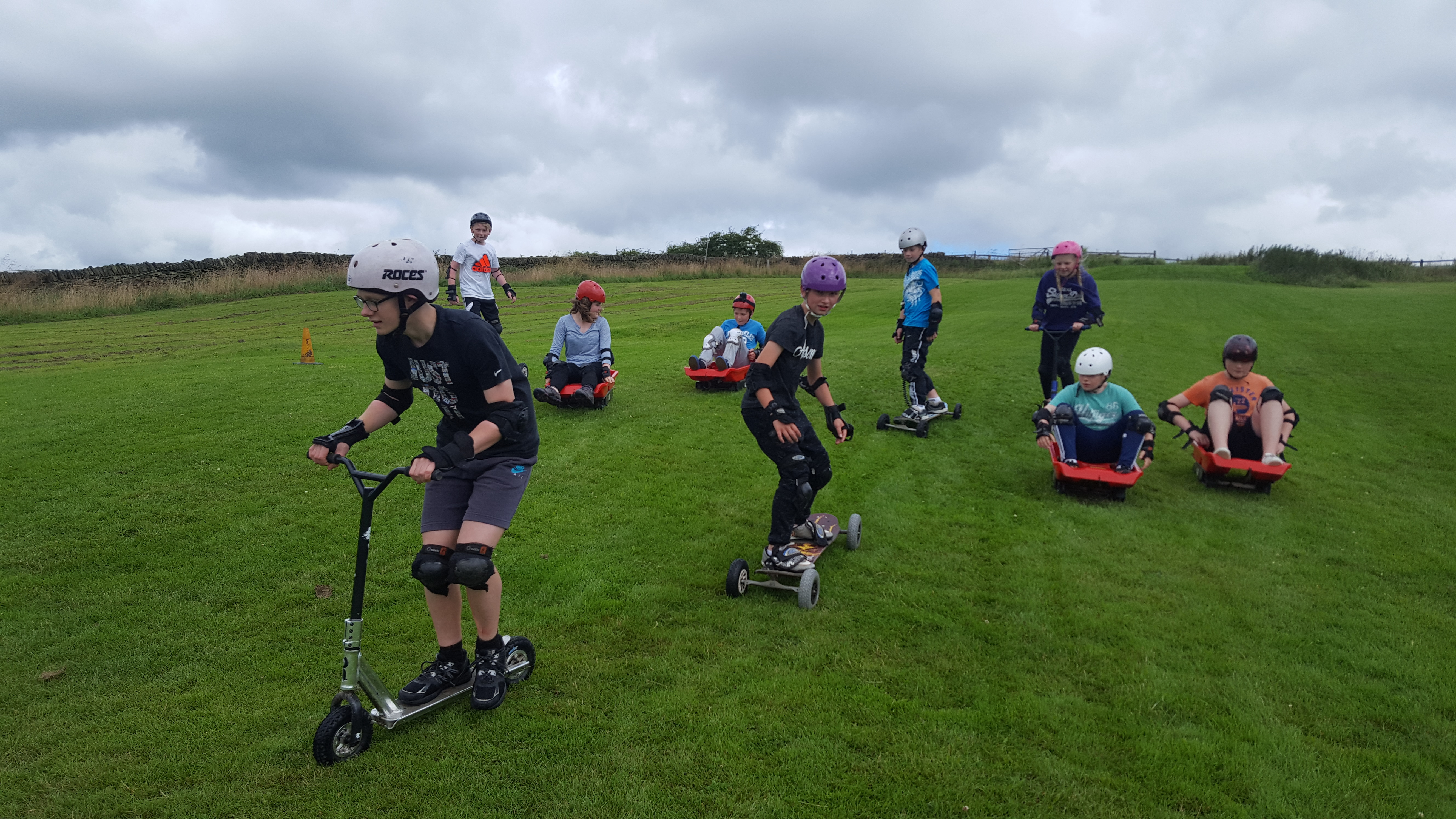 Mountainboarding grass sledging and dirt scooters